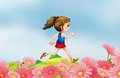 A girl running along the hill with a garden Royalty Free Stock Photo