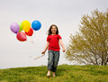 Girl Running With Balloons Stock Images