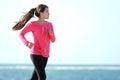Girl running on the beach happy healthy Stock Photo