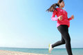 Girl running on the beach healthy in bright sunny day Royalty Free Stock Photos