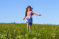 Girl running on the green field Royalty Free Stock Photo
