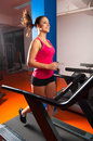 Girl running in the gym beautiful smiling on treadmill Stock Photo