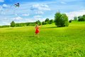 Girl running with kite Royalty Free Stock Photo