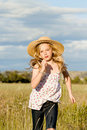 Girl running through long grass Royalty Free Stock Photos