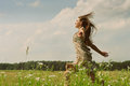 Girl running the meadow Stock Photography