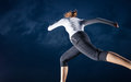 Girl running at night Royalty Free Stock Photo