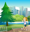 A girl running at the riverbank with a tall pine tree illustration of Stock Photo