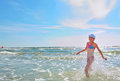 Girl running on water at sea beach Royalty Free Stock Image
