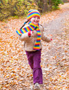 Girl runs in autumn park at day Royalty Free Stock Photos