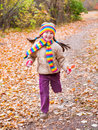 Girl runs in autumn park at day Stock Photos