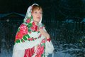 The girl in russian national costume winter evening Royalty Free Stock Image