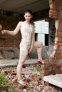 Girl in rusty building Stock Photo