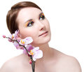 Girl's face and orchid Stock Photos