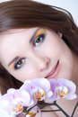 Girl's face and orchid Royalty Free Stock Photos