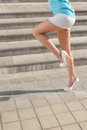Girl s long legs stock photo female model in white shoes running Royalty Free Stock Photography