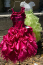 Girl s party dresses two fancy dress for girls on display at outdoor market in mexico Royalty Free Stock Images