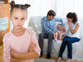 Girl sad because of jealous younger sister to parents Royalty Free Stock Photo