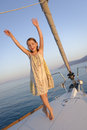 Girl on sailboat deck young dancing the forward of a small Stock Image