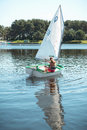 The girl in sailboat on the lake. Royalty Free Stock Photo