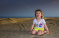 Girl on the sand dunes Royalty Free Stock Photo
