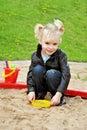 Girl sandbox summer playing toys Stock Image
