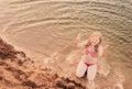 Girl in sandy beach happy Stock Image