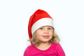 Girl with santa cap is looking in to the camera Stock Photos