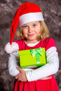 Girl with Santa- cap and present Royalty Free Stock Photo