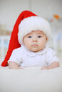 Girl in Santa Claus Cap Stock Image