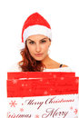 Girl with santa claus hat Royalty Free Stock Image
