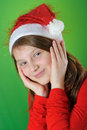 Girl with Santa Claus Hat Stock Photography