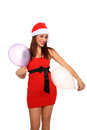 Girl with santa claus hat and balloons Stock Photos