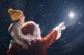 Girl and Santa Claus looking at Christmas star Royalty Free Stock Photo
