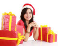 Girl in santa hat with christmas gifts Royalty Free Stock Photos