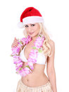 Girl with Santa hat and Hawaiian accessories Stock Photos
