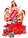Girl in Santa hat holding Christmas gift box. Stock Image