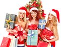 Girl in Santa hat holding Christmas gift box. Royalty Free Stock Photo