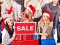 Girl in Santa hat holding Christmas gift box. Royalty Free Stock Photo