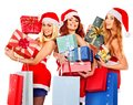 Girl in santa hat holding christmas gift box women stack Royalty Free Stock Image