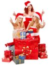 Girl in santa hat holding christmas gift box women stack Royalty Free Stock Photos