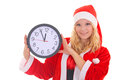 Girl with santa hat holding clock Stock Photos