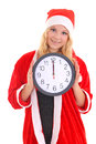 Girl with santa hat holding clock Royalty Free Stock Images