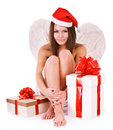 Girl in santa hat holding gift box isolated Stock Photos