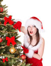 Girl in santa hat near christmas tree isolated Royalty Free Stock Photos