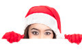 Girl in santa peeking over sign board paper cute funny photo closeup of christmas woman with copyspace isolated on white Royalty Free Stock Photography