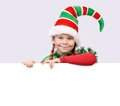 Girl santa s elf with the banner in suit of christmas white Stock Photography