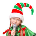 Girl - Santa's elf with a microphone Stock Images