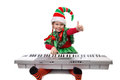 Girl santa s elf plays a synthesizer and showing sign ok isolated on white Royalty Free Stock Photography
