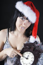 Girl in a Santa's hat holding the clock Stock Photos