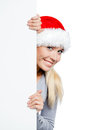 Girl in santa s hat keeps the copyspace isolated on white Stock Photography